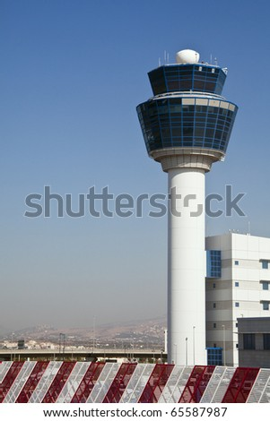 Air traffic control tower, viewed from the ground. - stock photo