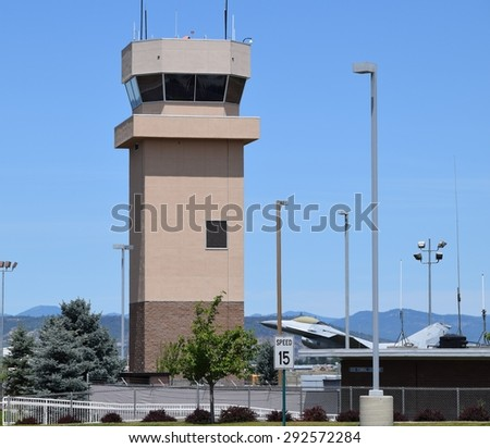 air traffic control tower with jet monument - stock photo
