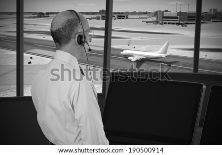 Air traffic controller at work - stock photo