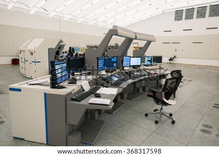 "Air Traffic Controllers in air traffic control center with monitors and radar in the""Bulgarian Air Traffic Services Authority"" (BULATSA), Sofia, Bulgaria, November 12, 2015."