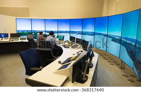 "Air Traffic Controllers in air traffic simulator center with monitors and radar in the""Bulgarian Air Traffic Services Authority"" (BULATSA), Sofia, Bulgaria, November 12, 2015."