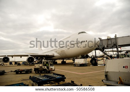 Air travel - A parked plane is loading off Passengers in an airport - stock photo