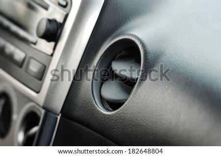air vent in small middle class  car, interior - stock photo
