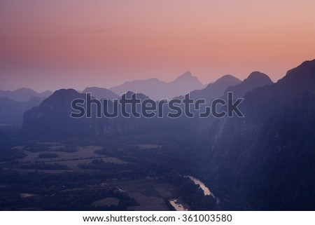 Air view of mountains on sunset in Laos