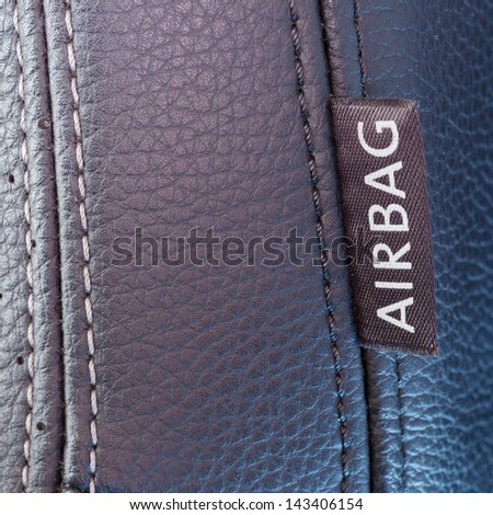 airbag label on the side of a car seat - stock photo