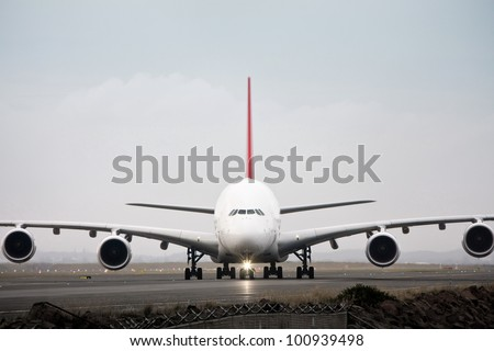 Airbus A380 jet airliner on runway - front view - stock photo