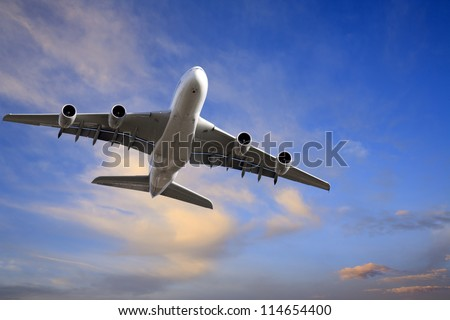 Airbus A380 taking off into beautiful twilight sky, with copy space. - stock photo