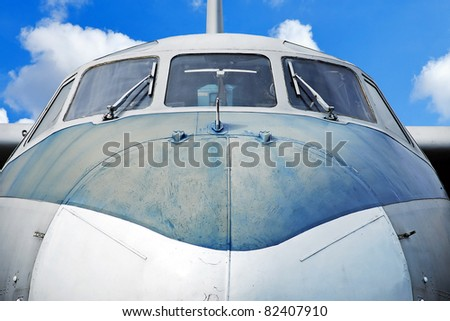 Aircraft against blue sky, close up - stock photo