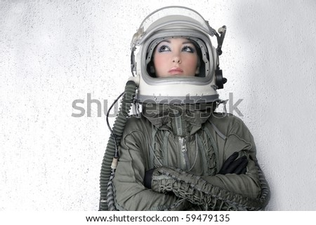 aircraft  astronaut spaceship helmet woman fashion portrait over silver - stock photo