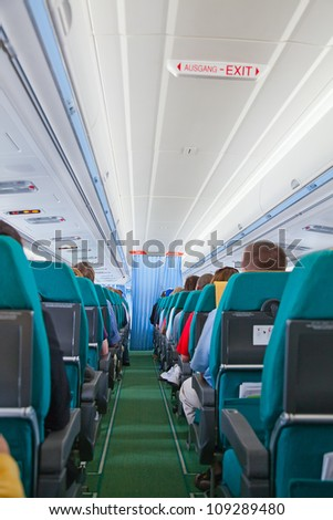Aircraft cabin after take off - stock photo
