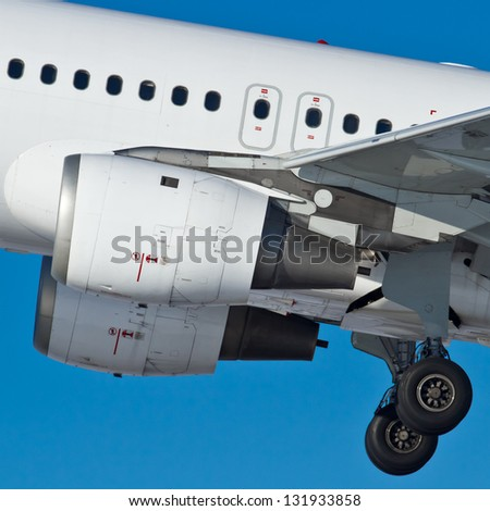 Aircraft engines and chassis at takeoff, closeup - stock photo