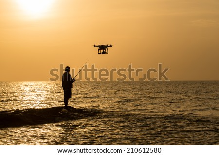 aircraft & Fishing man ,Fishing on the rocks ,Fishing on the rocky beach - stock photo