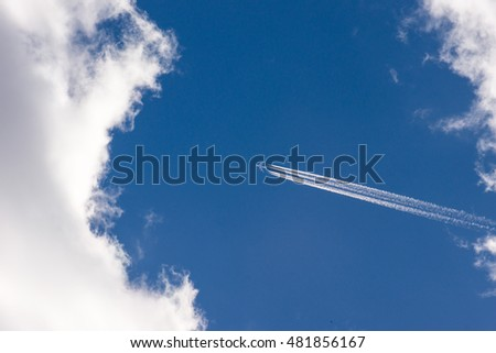 Aircraft flying high in the blue sky