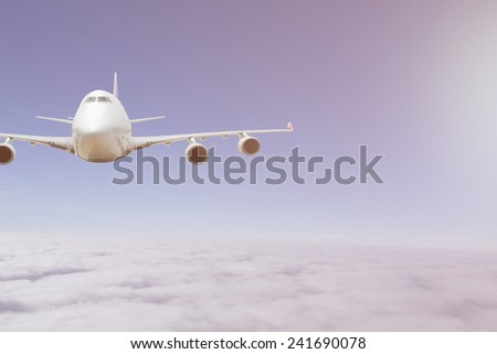 aircraft flying in the blue sky - stock photo