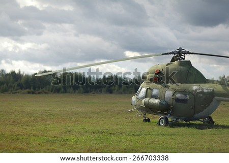 aircraft helicopter blue sky on the ground - stock photo