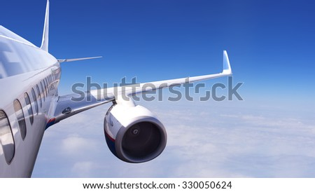 aircraft in flight on a background of blue sky and clouds - stock photo