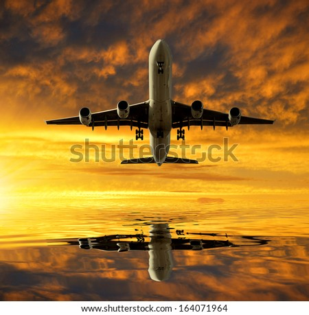 aircraft in the sunset - stock photo