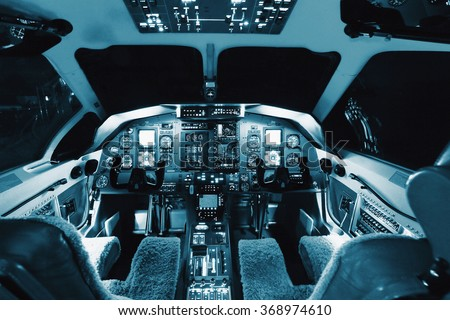 Aircraft interior, cockpit view inside turboprop plane. - stock photo
