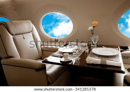 Aircraft (jet) porthole with blue sky view, flight by business class - stock photo