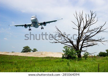 Aircraft landing gear, ready for planting, approaching for airfield - stock photo