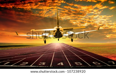 Aircraft landing on running track or athlete track - stock photo