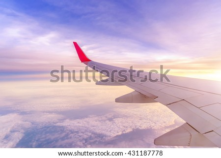 Aircraft left wing on sky in the morning