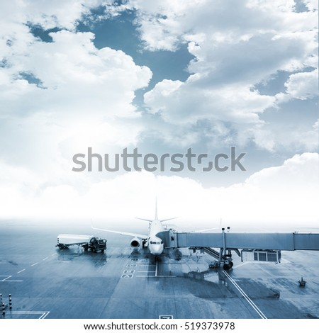 Aircraft maintenance, all markings erased, picturesque sky added