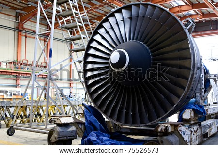 Aircraft maintenance, dismantled plane engine - stock photo