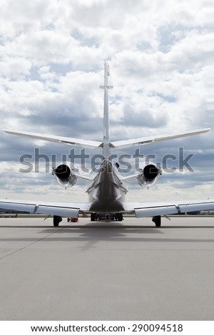 Aircraft Plane in front of the Airport with cloudy sky and sun - stock photo