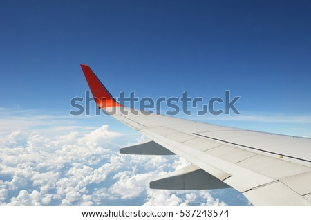 Aircraft wing on the sky