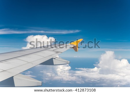 aircraft wing with blue sky background
