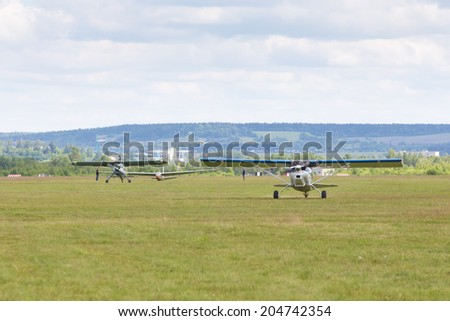"Airfield Frolovo,Russia - June 29,2014.Festival ""Wings of Parma 2014"".airplanes on field ready to fly"