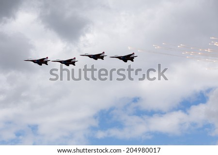"Airfield Frolovo,Russia - June 29,2014.Festival ""Wings of Parma 2014"".Swifts aerobatic team on the MiG-29 produce fireworks"