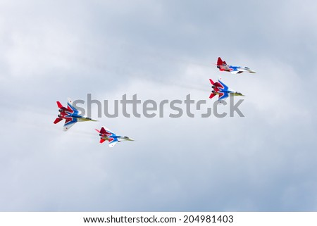 "Airfield Frolovo,Russia - June 29,2014.Festival ""Wings of Parma 2014"".Swifts aerobatic team on the MiG-29"