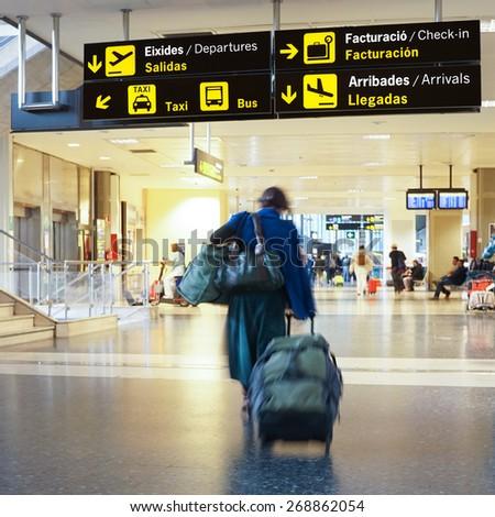 Airline passengers inside an International Airport.  - stock photo