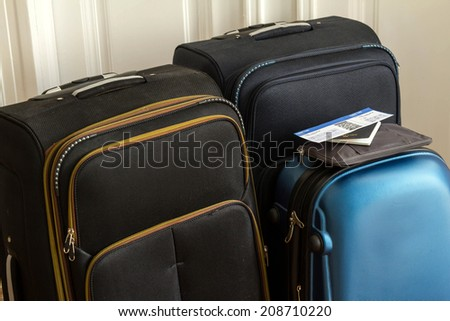 Airline ticket, passport and luggage, ready to travel  - stock photo