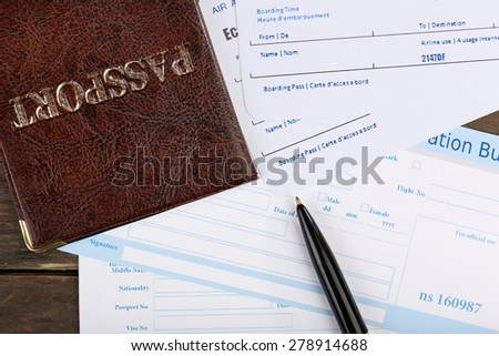 Airline tickets and documents, closeup - stock photo