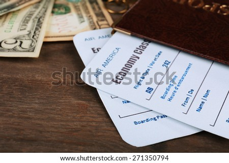 Airline tickets and documents on wooden background - stock photo