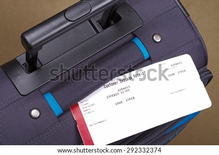 airline travel tag and suitcase