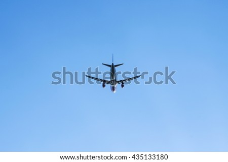 Airliner and Clear Blue Sky. Copy Space and Background Photo. - stock photo