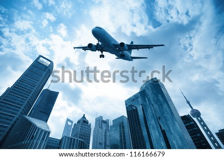 airliner and modern city in shanghai, China