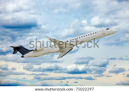 Airliner in the cloudy sky - stock photo