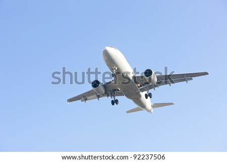 airliner makes its landing approach to oporto airport - stock photo