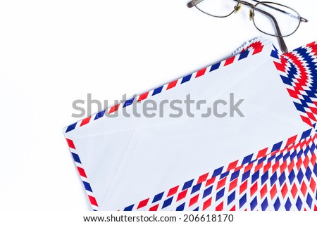 Airmail envelope on white background - stock photo