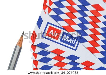Airmail letter and pencil on white background - stock photo
