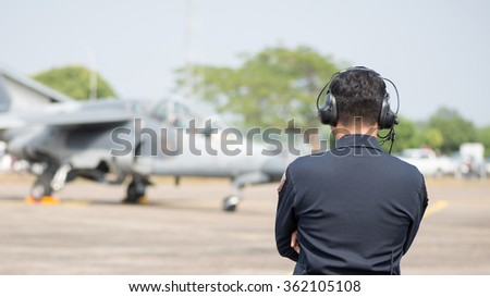 Airman talk to Jet pilot with radio communication. - stock photo