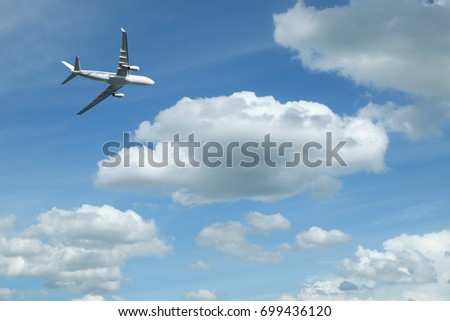 airplane against blue sky background