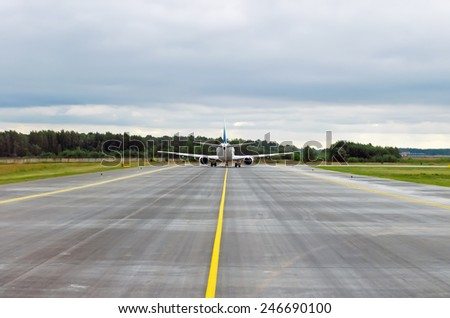 Airplane airport track off the band runway  - stock photo