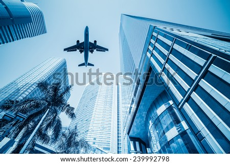 airplane and business buildings ,viewed from below  - stock photo