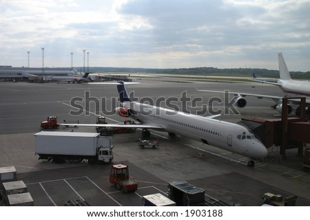 Airplane at airport - stock photo